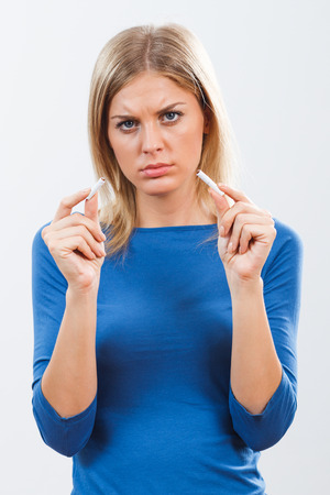bad habit: Young woman is sad because she has to stop with this  bad habit.