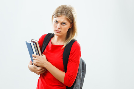 fed up: Angry female student is fed up of learning.