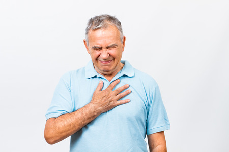 elderly pain: Senior man is having pain in chest. Stock Photo