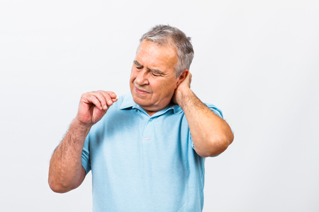 senior man on a neck pain: Senior man is having neck pain and he is about to take some pills to help himself.