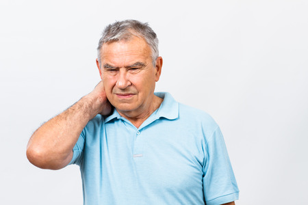senior man on a neck pain: Senior man is having neck pain.