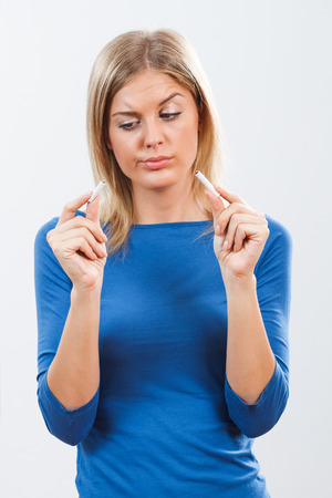 bad habit: Young woman decided to stop with this bad habit,but she is afraid will she make it. Stock Photo