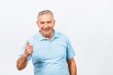 only one man: Portrait of happy senior man showing thumb up. Stock Photo