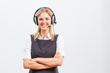 call center representative: Portrait of beautiful woman customer service representative with headphones.