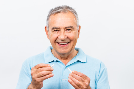senior smoking: Senior man has decided to stop smoking. Stock Photo