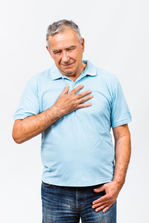 chest pain: Senior man is having pain in chest. Stock Photo