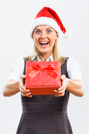 femme blonde: Beautiful business woman is holding Christmas gift.
