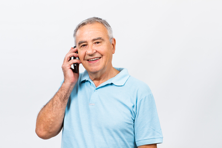 only men: Senior man is talking to someone on the phone.