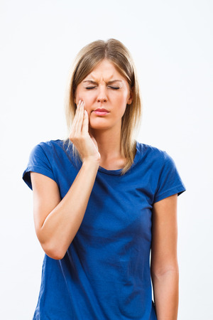 mouth closed: Young woman is having toothache. Stock Photo