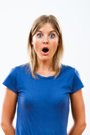 Young woman is very shocked because of something.
