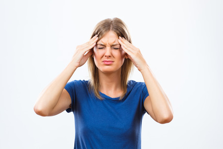 Young woman is having a headache. Stock Photo