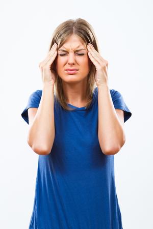 headache: Young woman is having a headache. Stock Photo