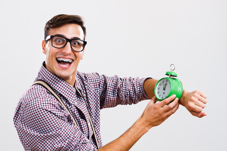 no time: Nerdy man is showing that there is no time to waste.