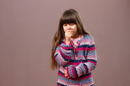 Little girl has got pain in her stomach and she is going to vomit. Stock Photo