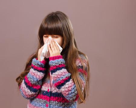 handkerchief: Little girl is sneezing into handkerchief.