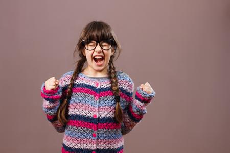 attitude girls: Angry little nerdy girl Stock Photo