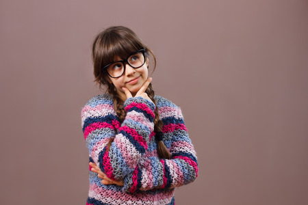 expression facial: Little nerdy girl thinking