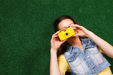 woman lying down: Woman lying down on the  grass and photographing.
