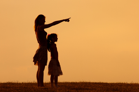 Mother and daughter enjoy spending time together in nature.