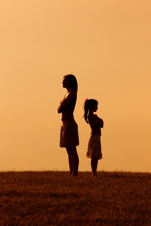 Silhouette of a angry mother and daughter on each other. Stock fotó