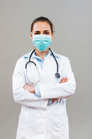 protective mask: Portrait of female doctor with protective mask looking at camera.