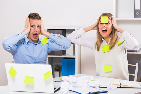 too much work: Businessman and businesswoman are having too much work to do.