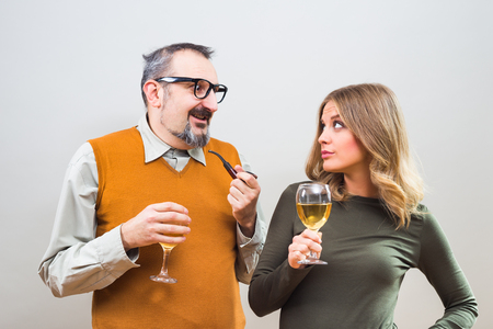 blind date: Self confident nerdy man is trying to get beautiful womans attention but she is not interested.