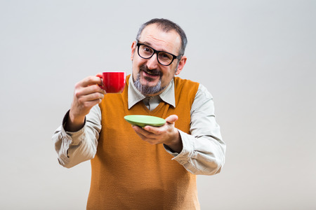 one mature man only: Funny nerdy man enjoys drinking coffee.
