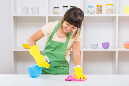 Happy little girl enjoys cleaning.