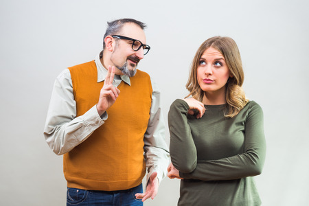 unrequited love: Nerdy man is trying to get beautiful womans attention but she is not interested and angry ignore him.