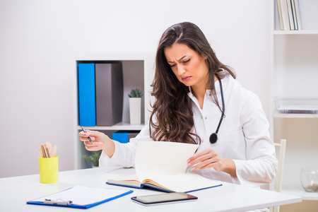 Female Doctor Having Headache While Working At The Medical Office ...