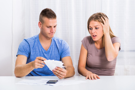 Young couple is having financial problems,husband is angry on his wife because she has spent a lot of money.