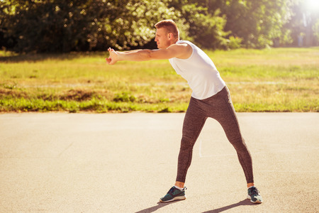 Young man exercising outdoor.Image is intentionally toned.