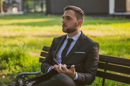 Elegant businessman working outdoor.Toned photo. 写真素材