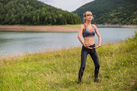 Woman exercise Tai Chi in the beautiful nature.