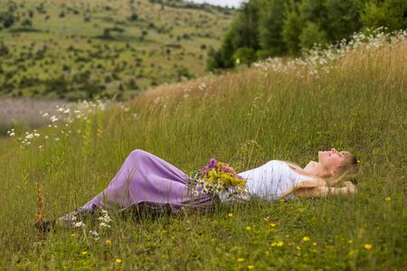 Woman enjoys resting in the beautiful nature.