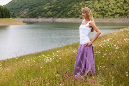 Woman enjoys spending time in the beautiful nature.