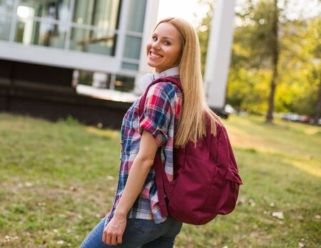 Portrait of beautiful female student standing outdoor.