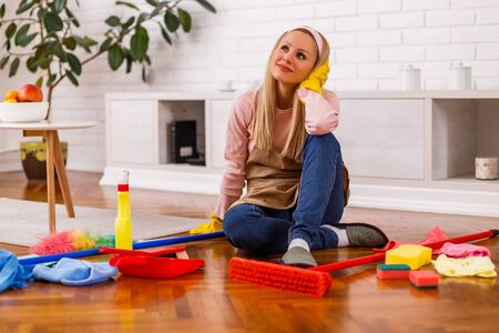 Housewife taking a break while cleaning her home. Stock fotó
