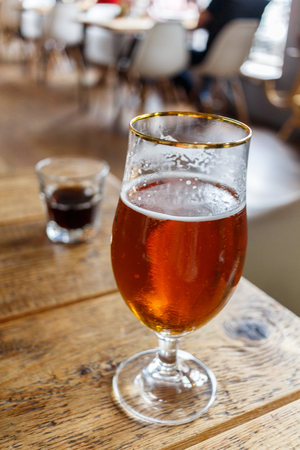 brewery: glass with beer on a table in the restaurant Stock Photo