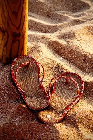 flip flops: Flip flop on the sand of the beach