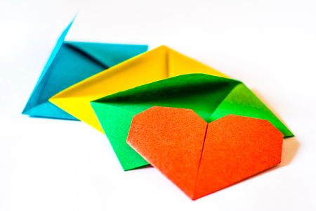 three envelopes with red heart