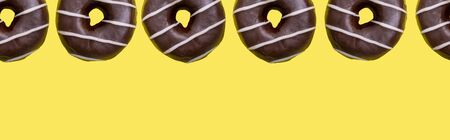 banner, donuts on a yellow background, template with space for text Stock Photo