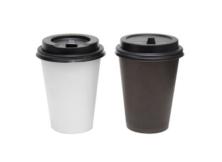2 paper cups of coffee, black and white, on an isolated background. The concept of opposites. layout with text placement. Stockfoto
