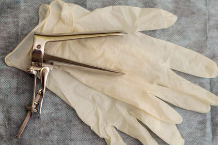 Sterile medical instrument for gynecological examination and gloves.