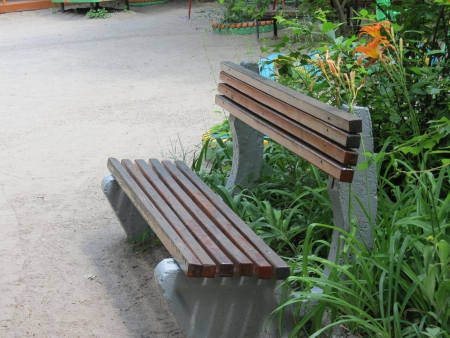 A bench for rest on one of the sites in kindergarten                              photo