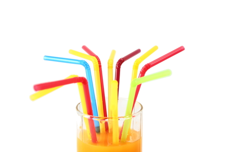 tubules: multicolored tubules In a glass of juice