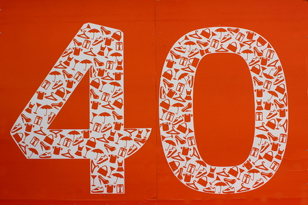 haberdashery: On an orange background number forty in which white icons of clothing, footwear, haberdashery
