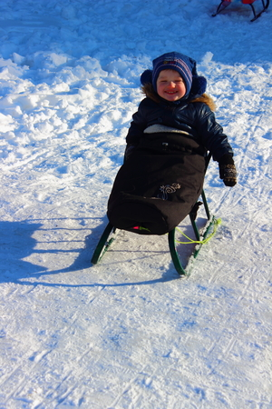 sledging people: little boy on a sled