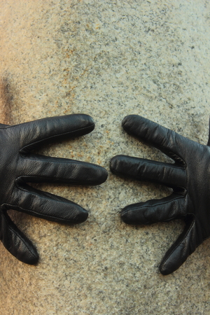 repel: two hands in gloves repel each other Stock Photo